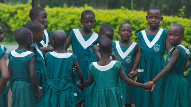 Educators Teachers and Teaching Assistants to Improve Education in Uganda's city photo