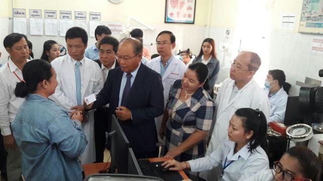 Learn social impact frameworks and use it for: Health Minister presents e-health card to patient